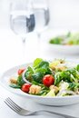 Fresh salad with olives, prawns, lemons and sauce Stock Photo