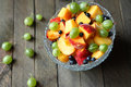 Fresh salad with peach and gooseberry food close up Stock Image