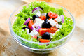 Fresh salad spring with vegetables and cheese selective focus in the middle of Stock Image