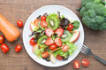 Fresh salad with strawberries, kiwi, tomatoes and apples Royalty Free Stock Photo