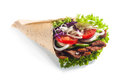 Fresh salad taco or tortilla wrap or doner with healthy lettuce tomato onion cucumber and meat served for a quick takeaway snack Royalty Free Stock Images