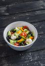 Fresh salad with tomatoes, cucumbers, peppers, olives and cheese in a ceramic bowl Royalty Free Stock Photo