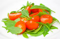 Fresh salad with tomatoes and rucola on plate Stock Photos