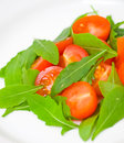 Fresh salad with tomatoes and rucola on plate Stock Photography