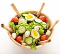 Fresh salad in a wooden bowl closeup of with croutons on white background Royalty Free Stock Photos