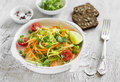 Fresh salad with zucchini and carrots in a light vintage plate Royalty Free Stock Photo