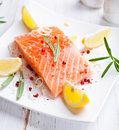 Fresh salmon fillet with spices and herbs Royalty Free Stock Image