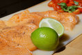 Fresh salmon and green lemon closeup of black peppers tomatoes chili Royalty Free Stock Image