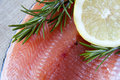 Fresh salmon green rosemary lemon Stock Photos