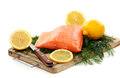 Fresh salmon with herbs and lemon. Royalty Free Stock Image