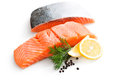 Fresh salmon with parsley and lemon slices Royalty Free Stock Photography