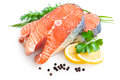 Fresh salmon with parsley and lemon slices Stock Images