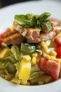 Fresh salmon salad on white plate Royalty Free Stock Photos
