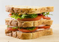 Fresh sandwich bread tomatoes lettuce and ham. Close up Royalty Free Stock Photo