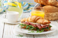 Fresh sandwich-croissant with ham, arugula, cucumber and cheese Royalty Free Stock Photo