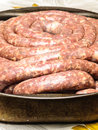 Fresh sausages closeup sausage on table in metallic tray before cooking process Royalty Free Stock Photos