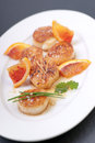 Fresh scallop on a plate Royalty Free Stock Photo