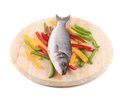Fresh seabass fish on wooden platter isolated a white background Stock Photo