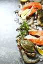 Fresh seafood: salmon steak, crabs and shrimps on stone background Royalty Free Stock Photo