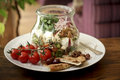 Fresh seasonal salad mixed with vegetables cheese and bread served in a jar Royalty Free Stock Photography