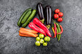 Fresh seasonal vegetables on black table top background