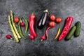 Fresh seasonal vegetables in row on black table top background
