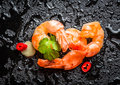Fresh shrimps on rock with water drops black Royalty Free Stock Image
