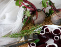 Fresh sliced organic beetroot with onion decorated on a white plate Royalty Free Stock Photo