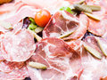 Fresh sliced raw beef meat with leaf lettuce on the table Royalty Free Stock Photos