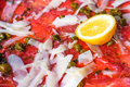 Fresh sliced raw beef meat with lemon on the table Royalty Free Stock Photos