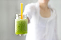 Fresh smoothie detox vegetable lettuce and cucumber in hand on the nature background soft focus Stock Photography