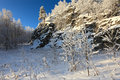 A fresh snow and hoarfrost on the trees and rocks in clear winter day blue pass south urals russia Stock Images