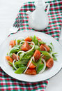 Fresh snow peas and tomato salad on plate vertical Stock Image