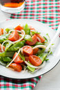 Fresh snow peas and tomato salad on plate vertical Stock Photo