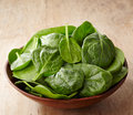 Fresh spinach leaves bowl of on wooden background Royalty Free Stock Image