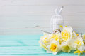 Fresh  spring yellow narcissus  flowers  and candle Royalty Free Stock Photo