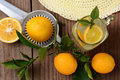 Fresh squeezed lemonade on a rustic wooden table with lemons sun hat and juicer horizontal format with an oldtime feel shot from a Royalty Free Stock Photos