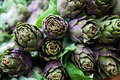 Fresh staple artichokes sold at an italian market of a in italy Royalty Free Stock Photos