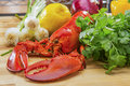 Fresh Steamed Lobster with Lemon and Fresh Vegetables Royalty Free Stock Photo