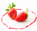Fresh strawberries as romantic dessert on a plate in heart sha shape of berry sauce selective focus Royalty Free Stock Photography