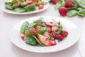 Fresh strawberries and baby spinach salad Stock Images