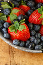 Fresh Strawberries and Blueberries in Colander Stock Images