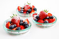 Fresh strawberries and blueberries in glass bowls Royalty Free Stock Photo