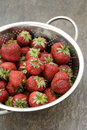 Fresh strawberries bowl of on dark background above view Stock Photography