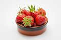 Fresh strawberries in a bowl isolated on white Royalty Free Stock Photos