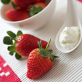 Fresh strawberries & cream Stock Images