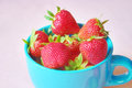 Fresh strawberries in a cup healthy fruit snack Stock Photos