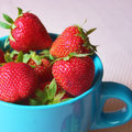 Fresh strawberries in a cup healthy fruit snack Stock Images
