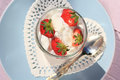 Fresh strawberries with fruit yoghurt and whipped cream Royalty Free Stock Photo
