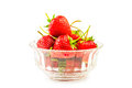 Fresh strawberries in a glass bowl on white background Stock Photos